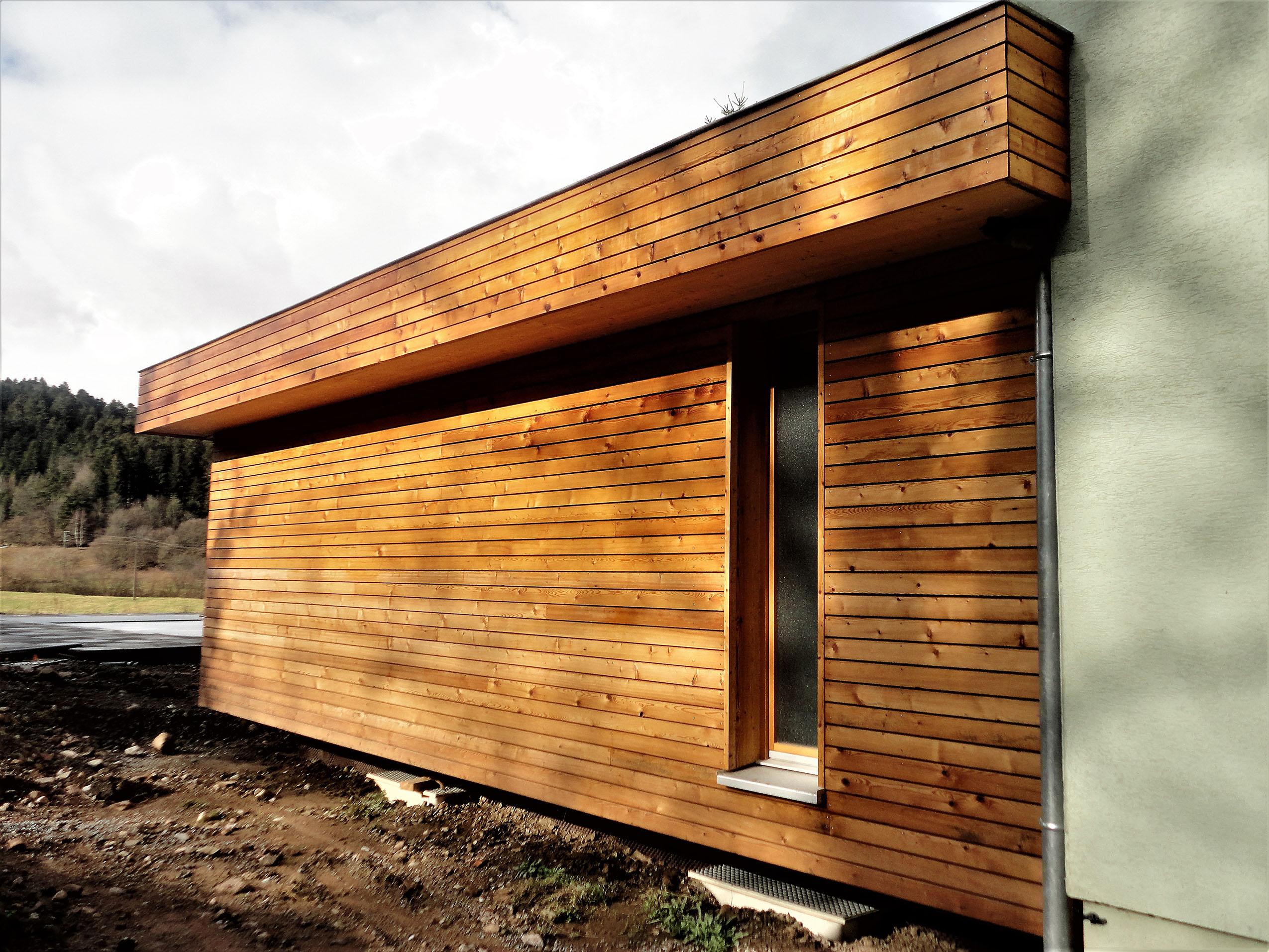 Extension bois et un espace salon s jour en plus for Bardage maison bois