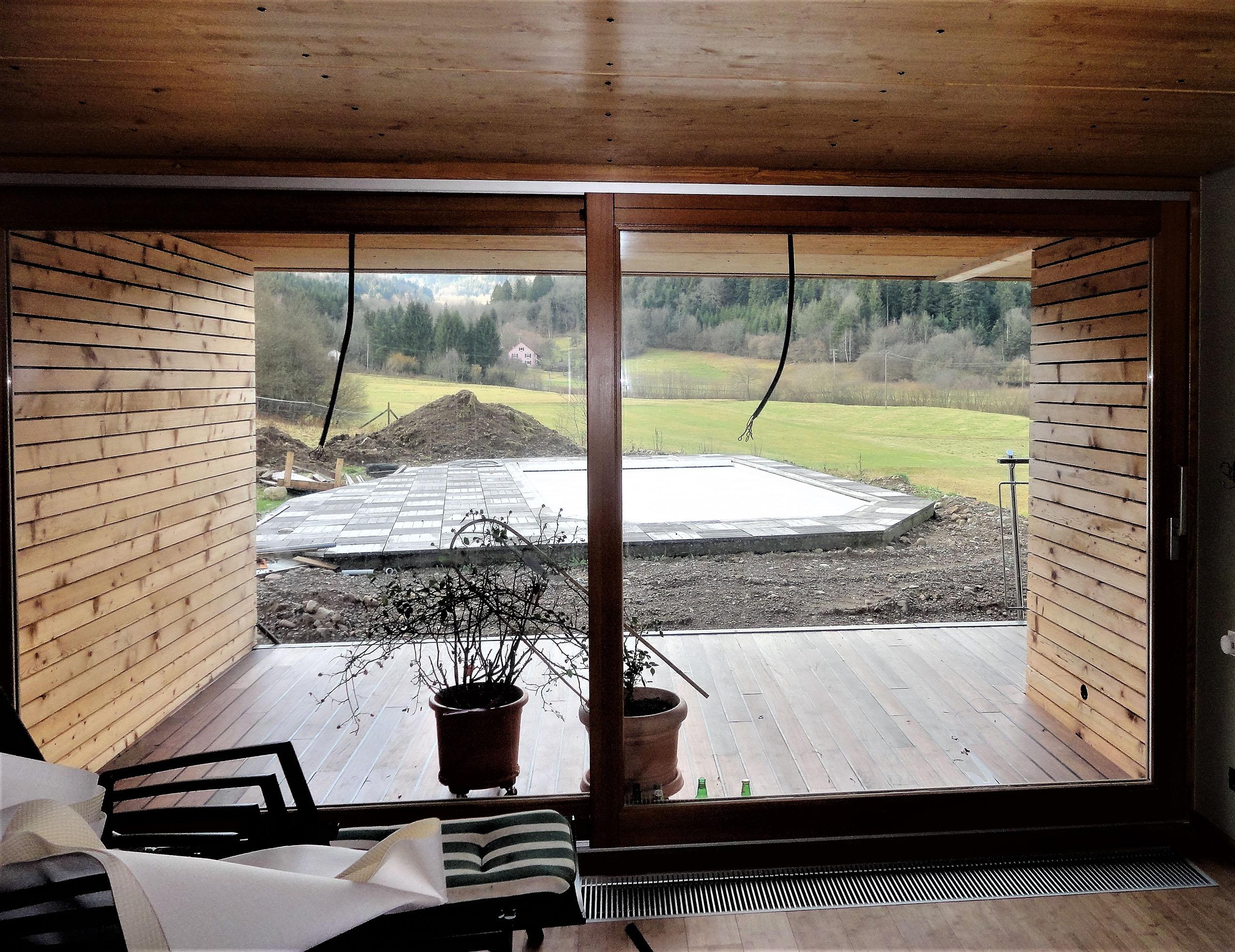 Extension bois et un espace salon s jour en plus for Avantages maison bois