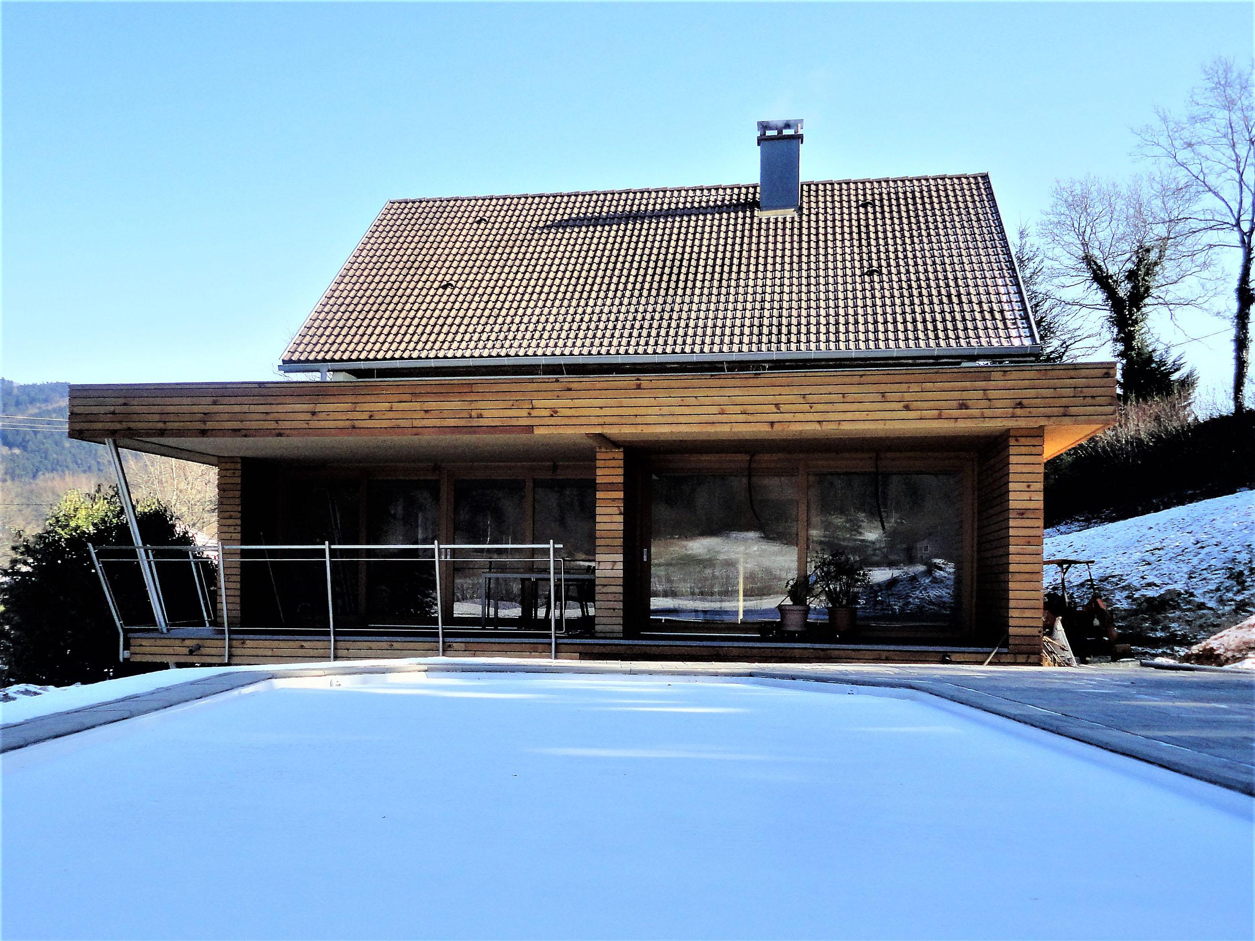 Extension bois et un espace salon s jour en plus for Agrandir sa maison en bois