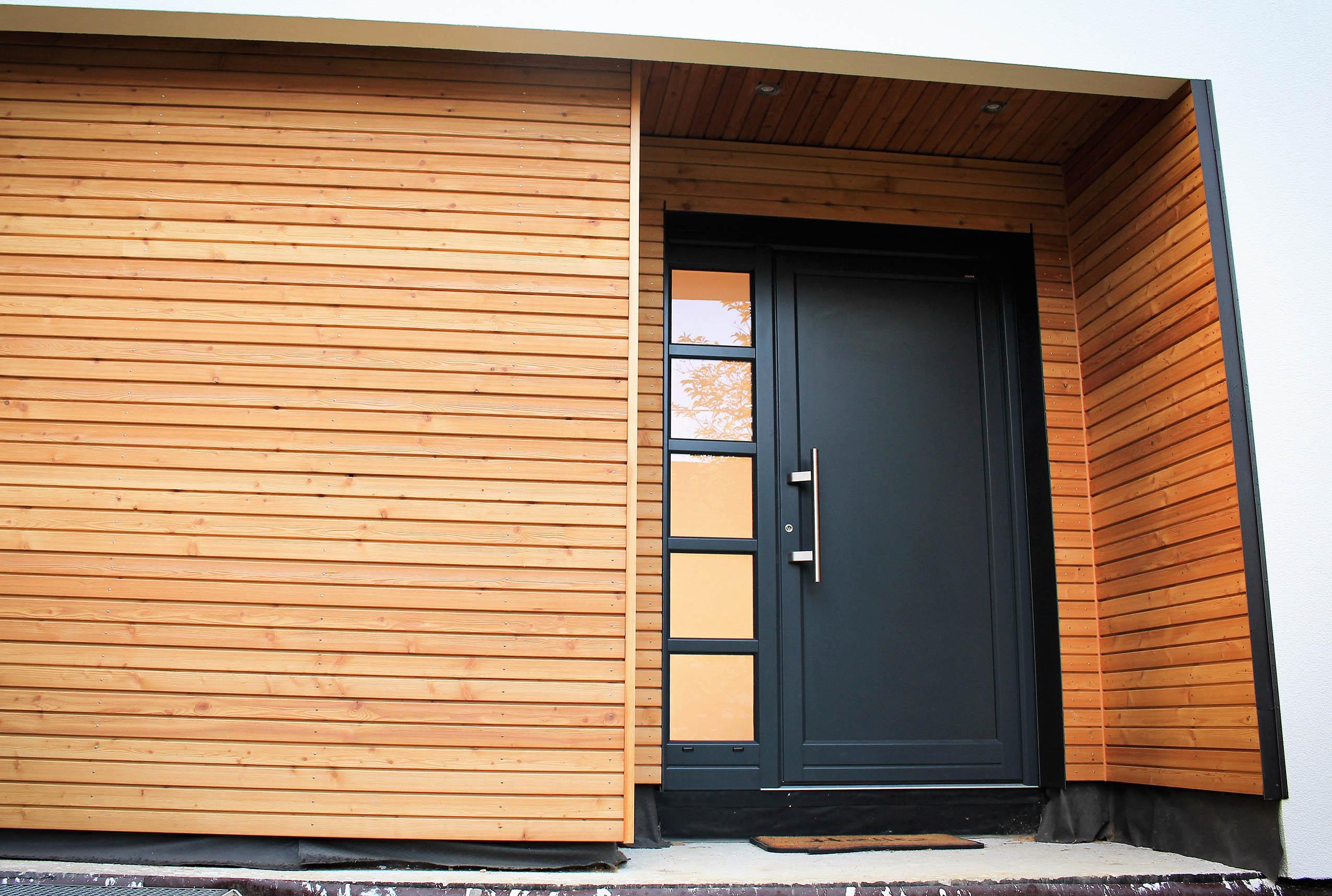 Construction d 39 une maison ossature bois contemporaine for Architecture maison bois